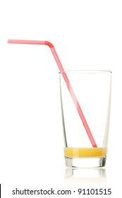 Glass of fresh orange juice with straw on white background