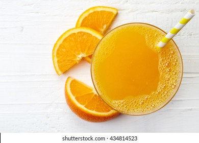 Glass of fresh orange juice from top view