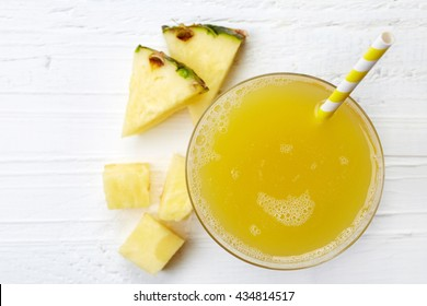 Glass of fresh pineapple juice from top view