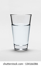 Glass of fresh pure water on light gray background