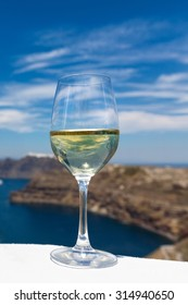 Glass of fresh wine by the sea, Greece, Santorini