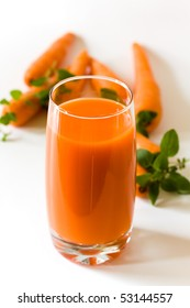 A glass of freshly squeezed carrot juice