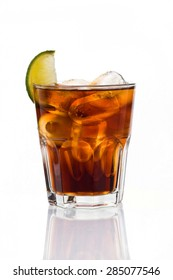 Glass of frozen cocktail with cola on white background. Rum with cola. Isolated.