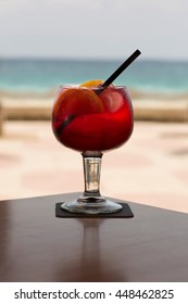 Glass of frozen sangria by Spanish seaside