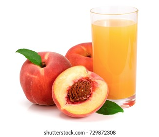 Glass of fruit juice and cut peaches isolated on white background