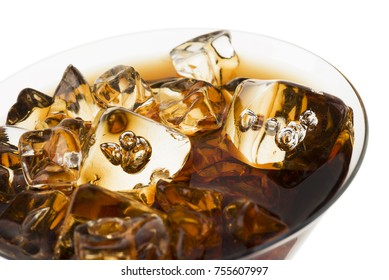 glass full of fresh cola with ice cubes, on white background