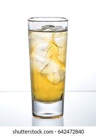 glass full of fresh drink on ice