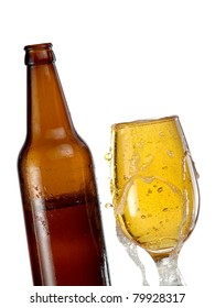 Glass fully with beer and a bottle
