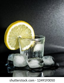 Glass of gin, ice and lemon