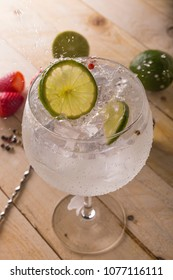Glass of gin tonic cucumber,lime and ice