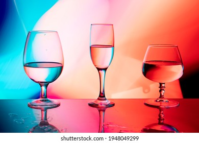 glass glasses on a multicolored background