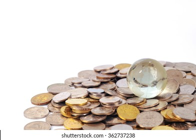 Glass globe and coins