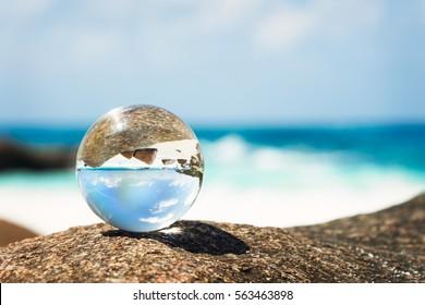 a glass globe on the beach