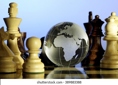 Glass globe on chess board