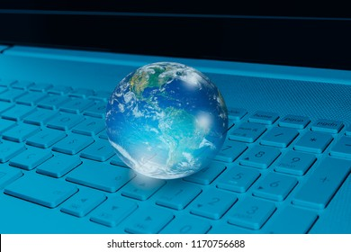 """Glass globe on laptop keyboard """"Elements of this image furnished by NASA """""""