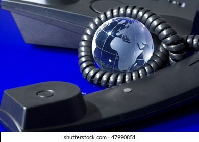 Glass globe with phone. Global communication concept.