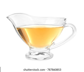 Glass gravy boat with apple vinegar on white background