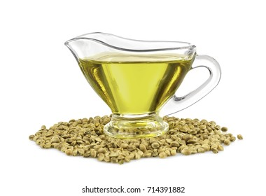 Glass gravy boat with hemp oil isolated on white
