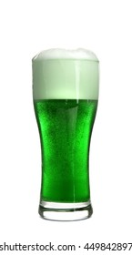 Glass of green beer on white background