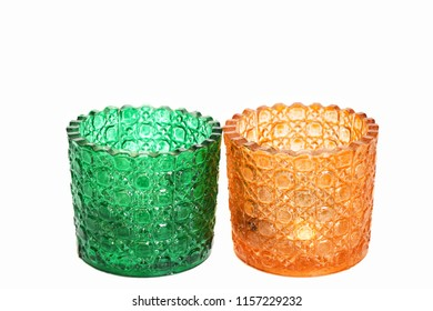 Glass of green and orange candles Placed on a white background.