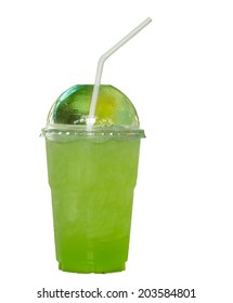 A glass of green water on white background.