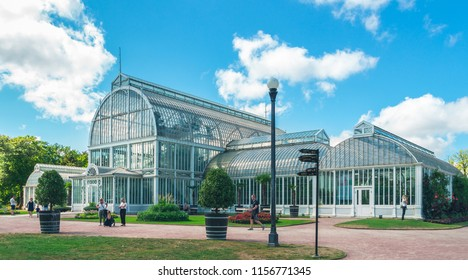 Glass greenhouse in Gothenburg, Sweden. Side view. Beautiful glass building. Transparent Palm House with arcs in Garden Society of Gothenburg, one of the best-preserved 19th century parks in Europe.