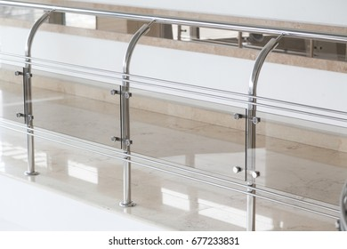 Glass guard rails in business office building