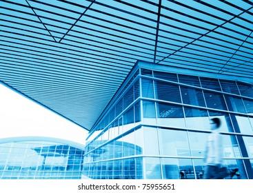 Glass hall, modern architecture, blue tones.