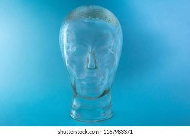 Glass Head Shape on bright blue background