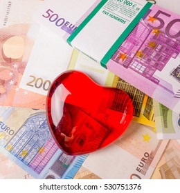 Glass heart with Euro. euro banknotes.  love and money