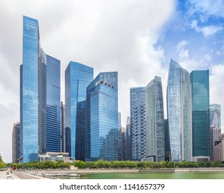 Glass high skyscrapers in the center of Singapore on the waterfront. Skyline financial center of the city, new modern office buildings.