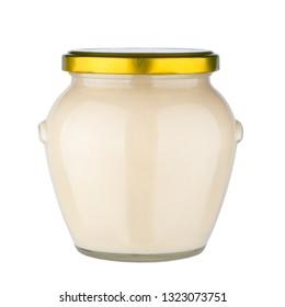 Glass honey jar isolated on white background.