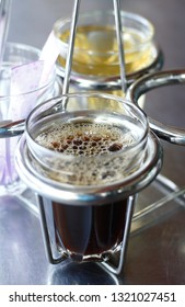 a glass of of hot black coffee serve with a glass of hot tea for breakfast coffee.