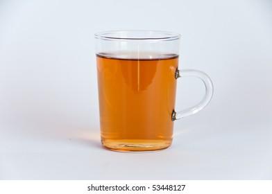 A glass of hot black tea