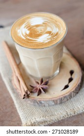 a glass of hot coffee on wooden table, vintage coffee