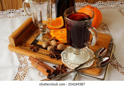 A glass of hot mulled wine and spices