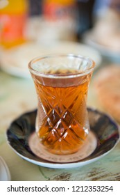 glass of hot Turkish tea in a beautiful crystal galss