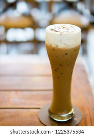 Glass of ice coffee on table.