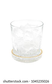 glass with ice cubes and coaster isolated on white background