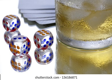 glass with ice cubes and dice