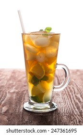 Glass of ice tea with lemon and mint