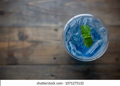 glass of Iced blue hawaii soda on table