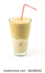 Glass of iced coffee with milk isolated on white
