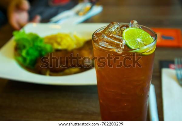Glass of iced tea with lemon