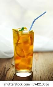 Glass of iced tea with lemon on a windowsill