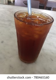 A glass of iced tea on a hot day