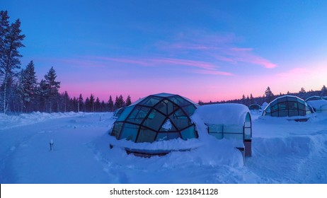 Glass igloo at Kakslauttanen Arctic Resort Finland during magical polar twilight