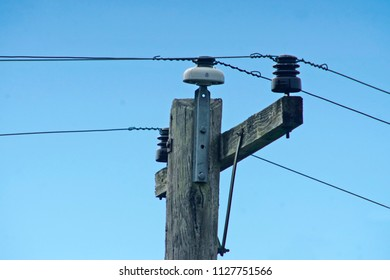 glass insulator on top of a power pole