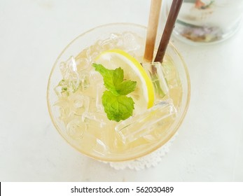 a glass of italian soda, focus on what is in a glass in a warmwhite light. make it look fresh and tasty.