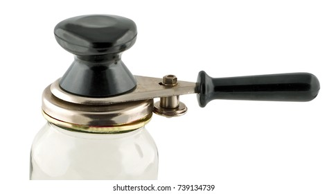 Glass Jar and can lid closing machine for canning isolated on a white background